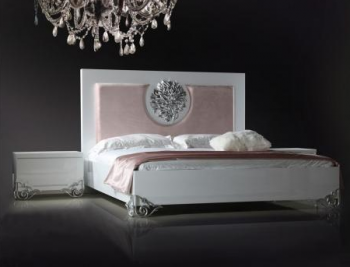 Queen sized bed with white trim
