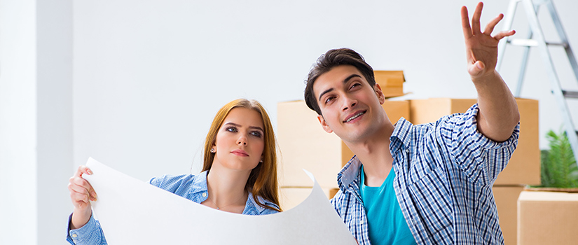 A couple plans where they will place their furniture in their new home.